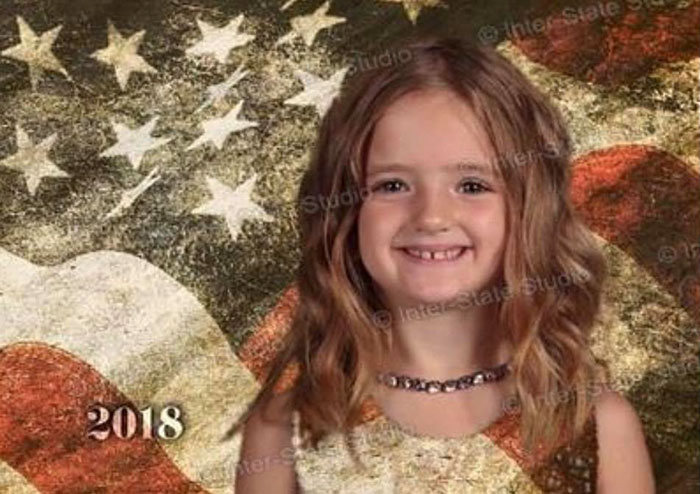 Girl wears green to school photo and becomes see through.